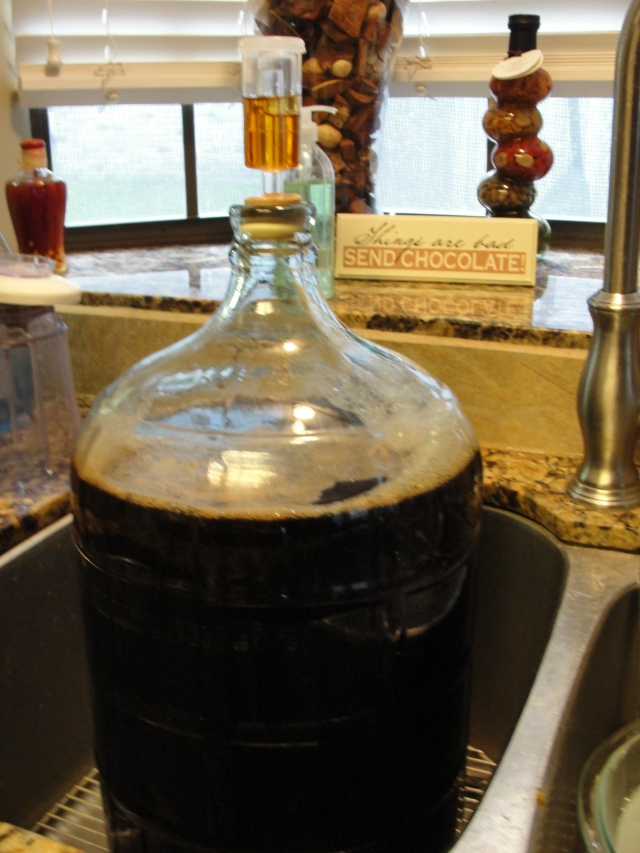 5 gallons of my Imperial Stout, boubon infused and toasted oak resting on the bottom. Note the bourbon in the airlock!