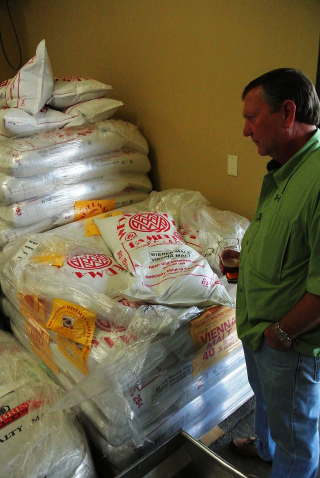 John taking a gander at the grain bags waiting their turn to become elixirs of the gods.