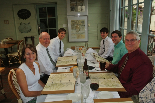 Dinner at son Joe's graduation - he is far right, my big maroon body with my Red Rocket Ale is near right.