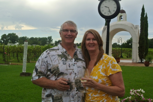 Enjoying our wine overlooking the warm and humid winery and vineyard grounds.