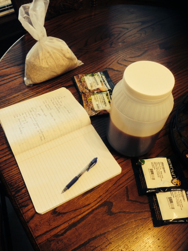 Brewing notebook, malt extract, grains and hops. Ready to brew.