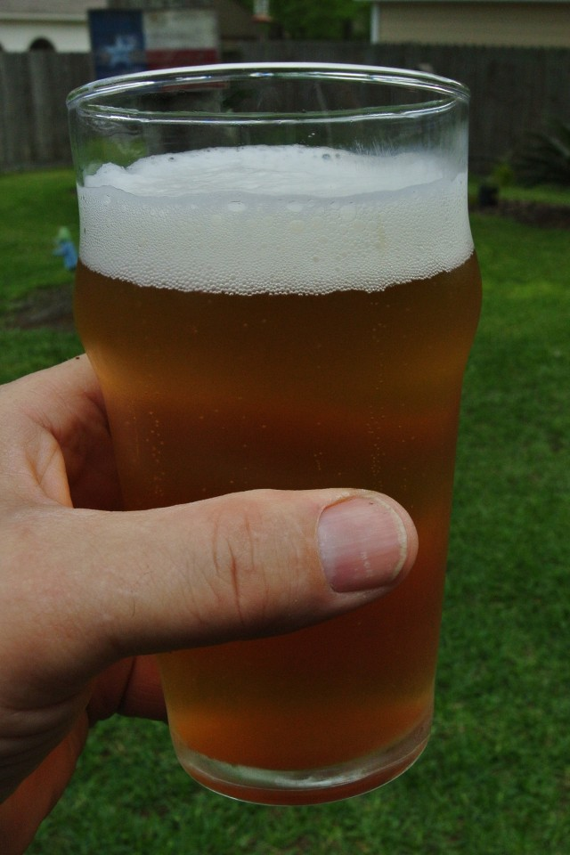 Ah, A Naked Golden Blonde Ale with a freshly mown lawn in the background!