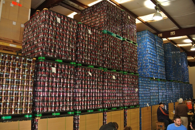 Empty cans waiting to be filled with the liquid gold! The blue cans are the Bombshell Blonde, the number on seller and the Buried Hatchet Stout the brown cans.
